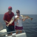 newlywed-couple-fishing-with-capt-dave-pelican-state-fishing-charters-4