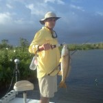 son-showing-off-his-reds-to-parents-pelican-state-fishing-charters