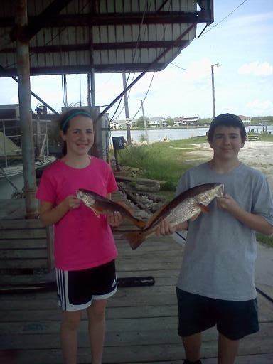 Kids having fun on the Bayou with Captain Dave of Pelican State Fishing Charters