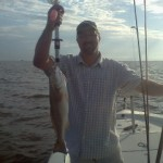 couple-enjoying-catching-redfish-with-pelican-state-fishing-charters