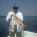 Healthy redfish with Captain Dave with Pelican State Fishing Charters