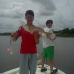 pierce-showing-off-just-one-of-his-fish-for-the-day-with-capt-dave